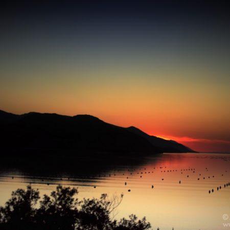 Czarnogóra, zachód słońca nad jeziorem